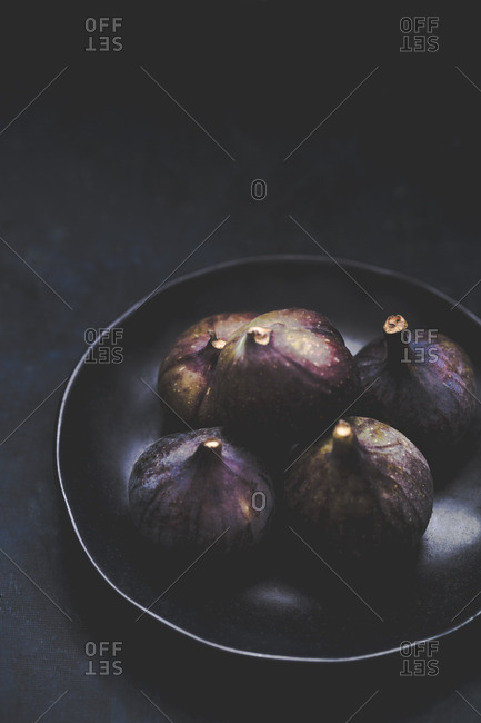Still life of fresh figs on indigo background