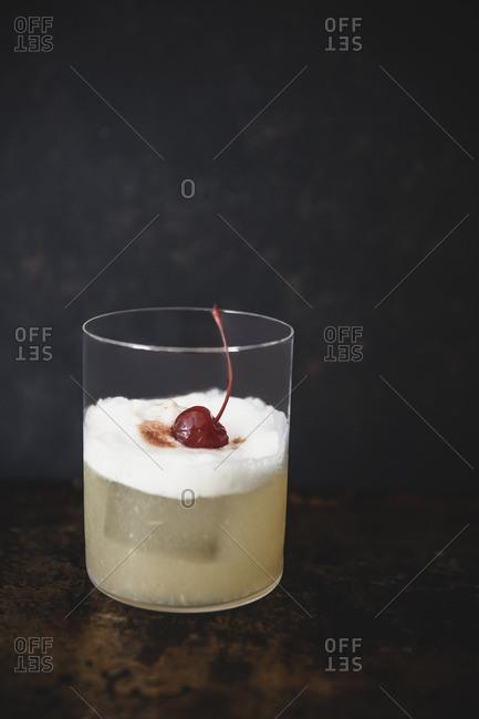Whiskey sour on a dark textured background