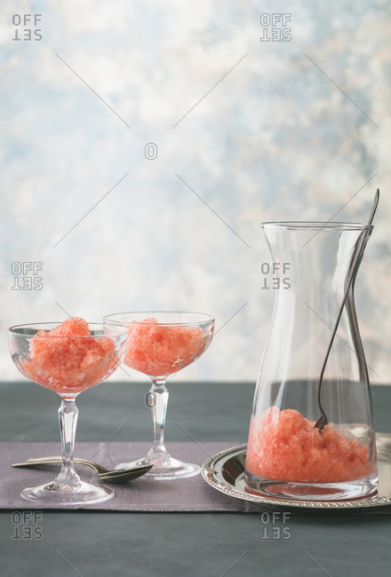 Watermelon granita in two glasses and a pitcher