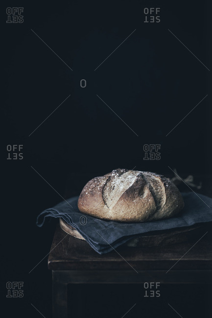 Rustic boule on old wooden table