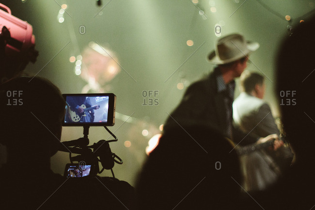 Camera person's monitor showing guitarist performing onstage