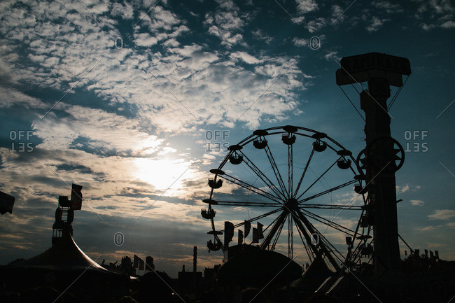 Silhouette of fair attractions at sunset