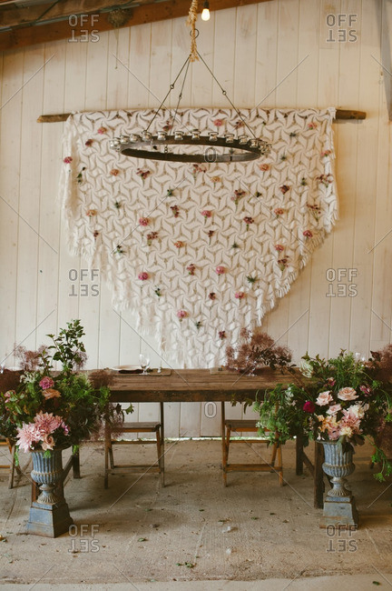 Table and flower decor in a barn wedding