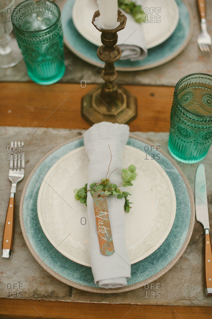 Place setting with name tag on a rolled napkin