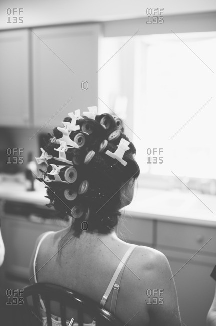 Rear view of a bride with rollers in her hair