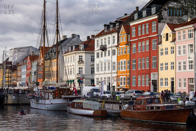 Copenhagen, Denmark - October 27, 2012: Famous Nyhavn street in Copenhagen with boats in the river