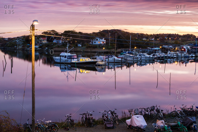 Gothenburg, Sweden - October 24, 2012: Sunset light reflection on the water in the docks of a Swedish island