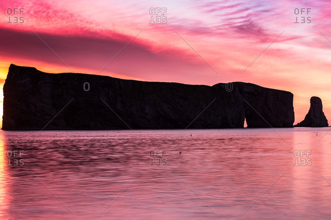 Perce Rock silhouette in pink sunset light