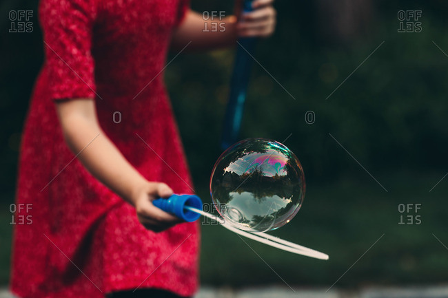 Girl catching a bubble