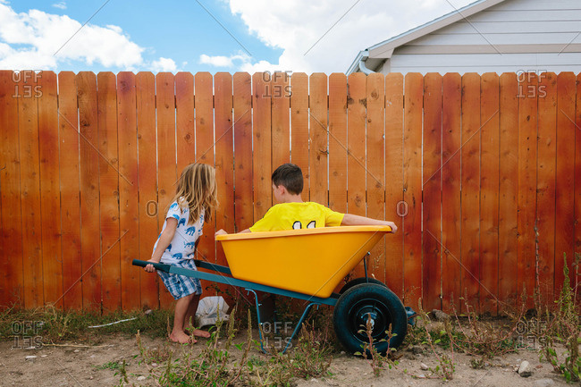 Kids playing with wheelbarrow - from the Offset Collection