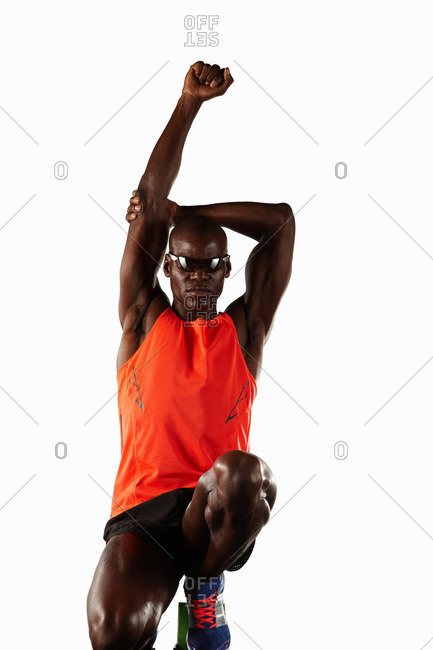 Runner stretching at starting line