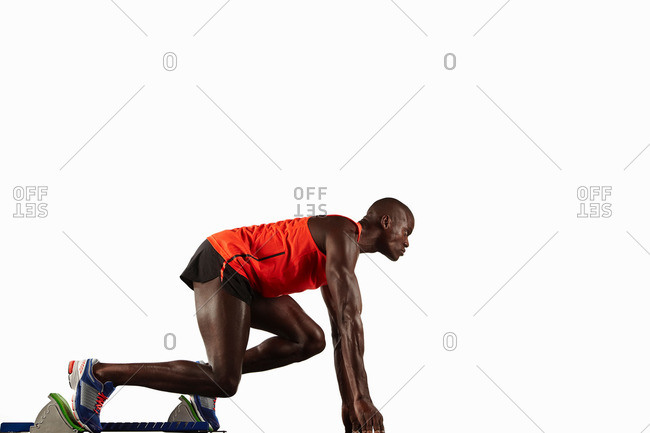 Runner crouched at starting line