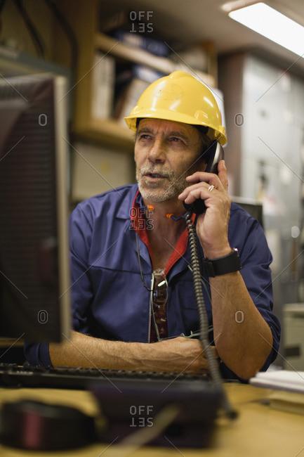 Worker talking on phone in office