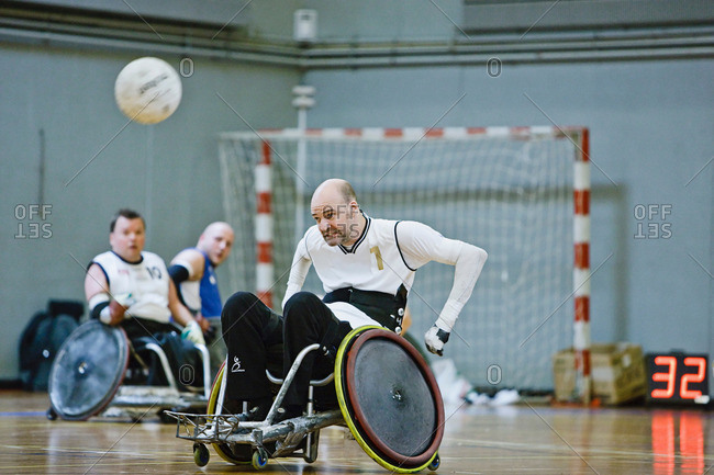 Men in wheelchairs playing pararugby