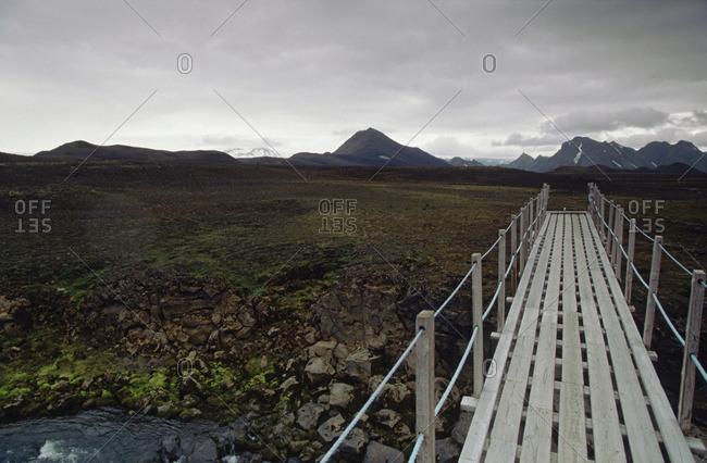 Wooden walkway over rocky ravine