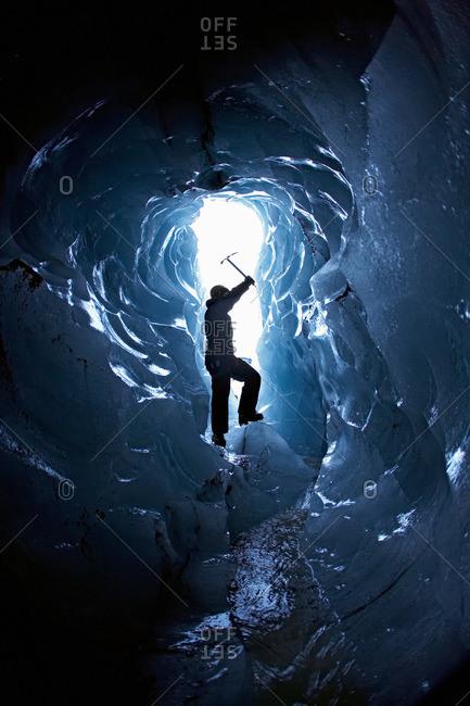 Man exploring glacial cave