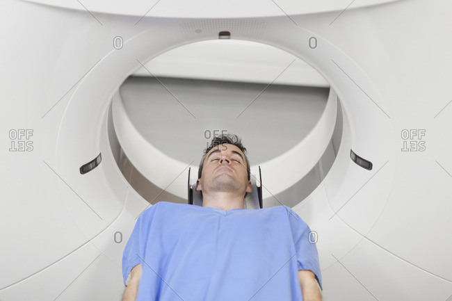 Patient laying in CT scanner in hospital