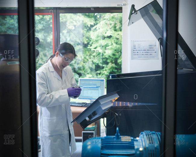 Scientist in laboratory with samples and analytical scientific equipment