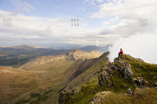 Hiker overlooking view from mountaintop