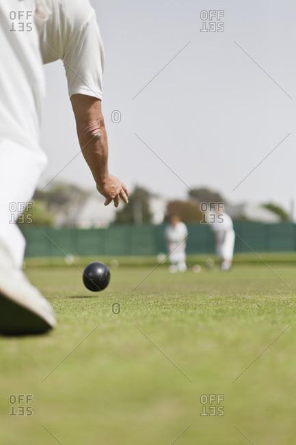 Older man lawn bowling - Offset
