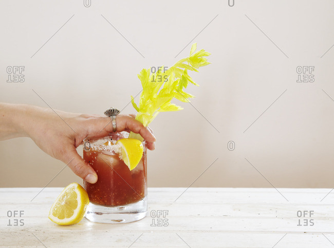Hand on Bloody Mary drink