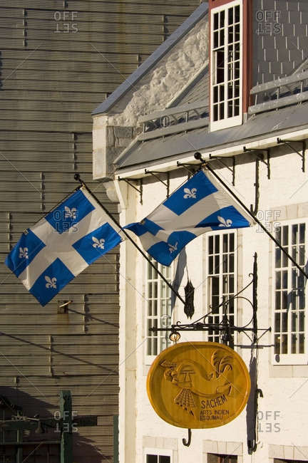 August 25, 2005: Quebec province flag on shop in Quebec city, Quebec, Canada.
