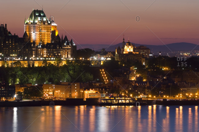 Chateau Frontenac Hotel from across St. Lawrence River at evening twilight, Quebec, Canada.