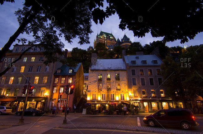 August 24, 2005: View up from Vieux-Port to Chateau Frontenac with classic buildings on rue du Petit-Champlain at twilight, Quebec, Canada.