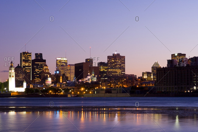 August 22, 2005: Evening view of skyline with old Montreal in foreground, across St. Lawrence River from Ile Notre-Dame, Montreal, Quebec, Canada.