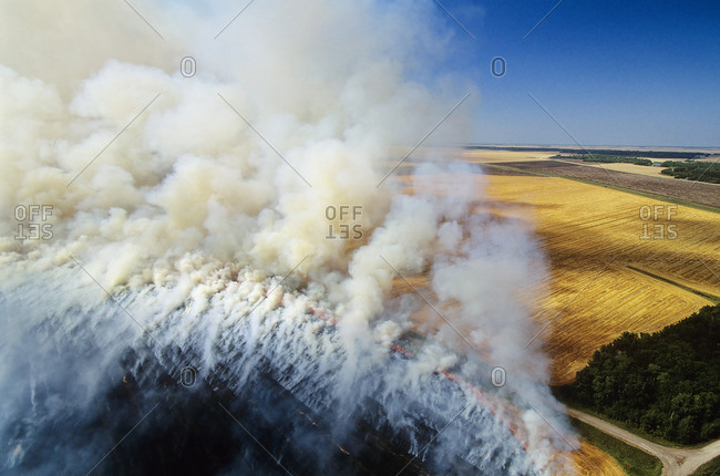 Aerial of residual crop burning in Manitoba, Canada.