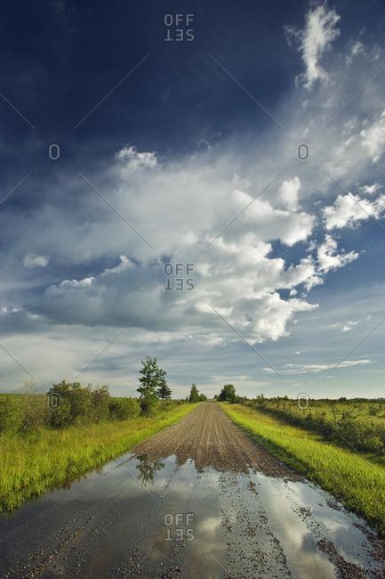Country Road after Rain storm near Cochrane, Alberta, Canada.