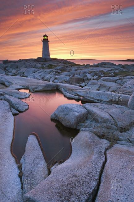 Peggy's Cove Lighthouse at dusk, Peggy's Cove, Nova Scotia, Canada.