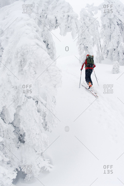 Man skis up Hollyburn Mountain. Cypress Bowl, West Vancouver, British Columbia, Canada.