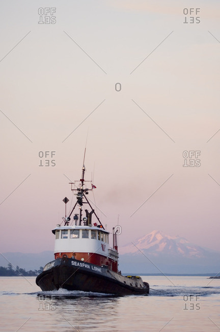 August 19, 2006: Ocean going coastal tugboat at twilight near Sidney, British Columbia, Canada.