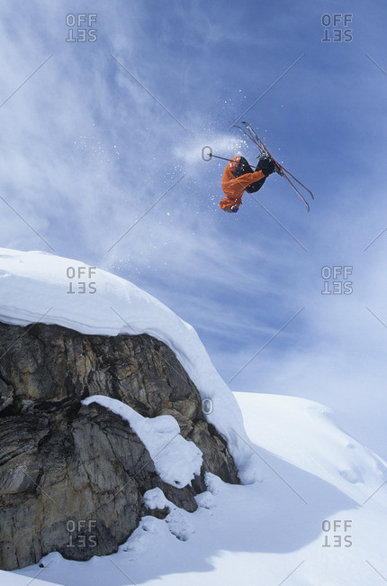 Man doing backflip while skiing, Sunshine Village backcountry, Alberta, Canada.