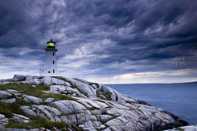 Lighthouse at Peggy\'s Cove during approaching storm, Nova Scotia, Canada.