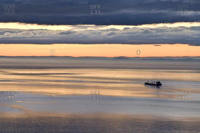Cargo ship descending the St. Lawrence River near Les Eboulements, Charlevoix, Quebec, Canada