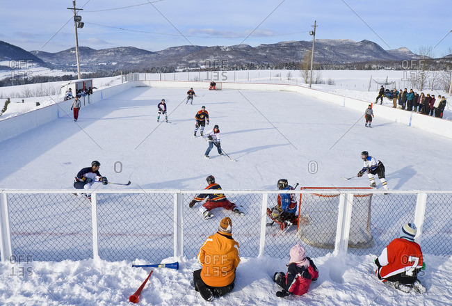 February 9, 2008: Hockey game played on a village outdoor rink on a pleasant Saturday afternoon, Les Les Aboulements, Quebec, Canada.