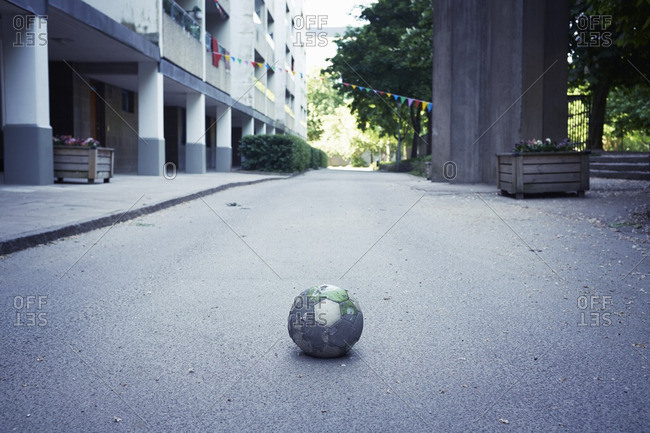 Deflated soccer ball in the street