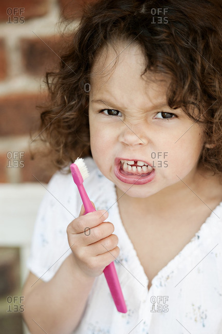 Angry girl holding toothbrush - Offset