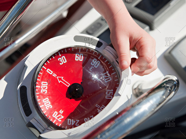 Boy with compass on yacht