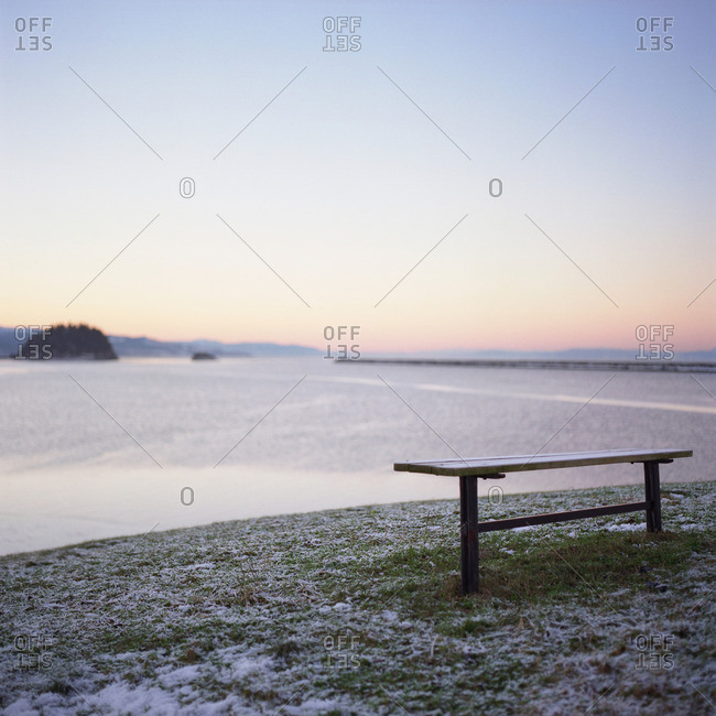 Bench by sea, wintertime - Offset