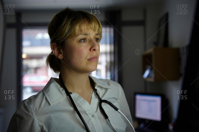 Doctor looking at screen in office