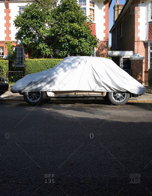 Car covered with car cover