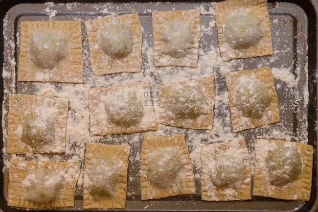 Top view of a tray  filled with homemade ravioli