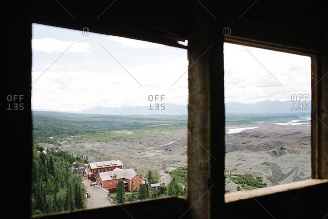 View through a window of the Kennecott Mines National Historic Landmark in Kennecott, Alaska