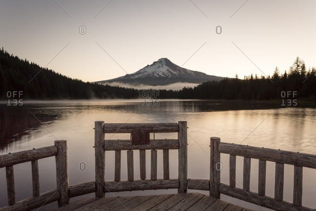View of Mount Hood and Trillium lake from a wooden dock at sunrise
