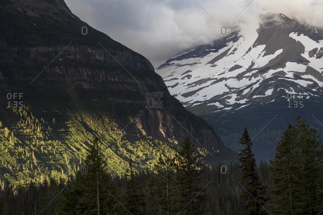 Sunlight shining into a mountain valley in Montana