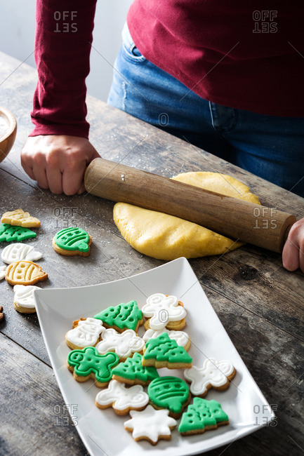 Young woman preparing dough for Christmas cookies