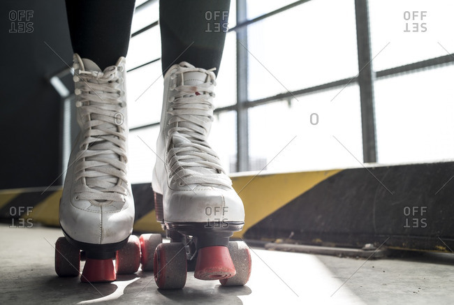 Feet of a person in retro white roller skates